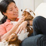 Asian woman with puppy.