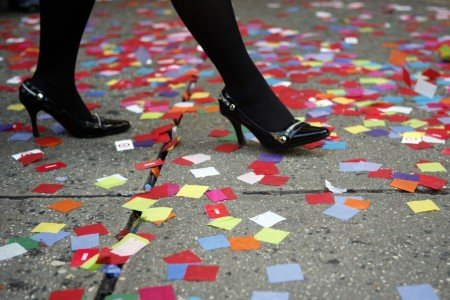 A woman walks on a sidewalk during New Year's Eve rehearsal in New York