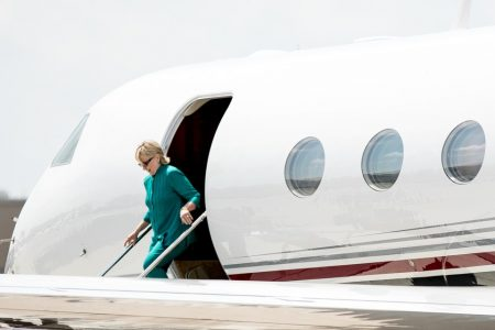 Democratic presidential candidate Hillary Clinton arrives at Des Moines International Airport in Des Moines, Wednesday, Aug. 10, 2016. Clinton is in town to tour Raygun, a printing, design and clothing company and attend a campaign rally. (AP Photo/Andrew Harnik)